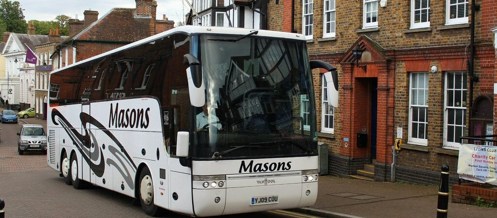 A picture of a Masons branded coach in a street