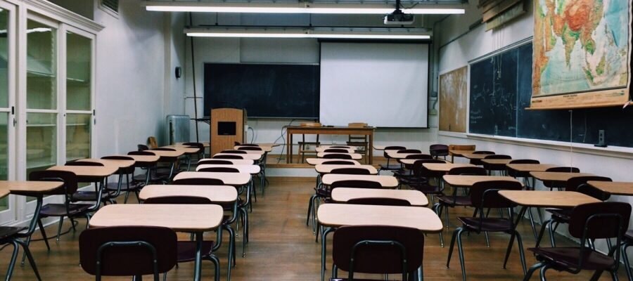an image of a school classroom with desks