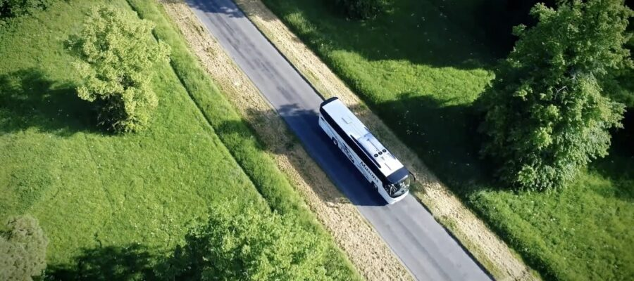An image of a coach driving through the countryside